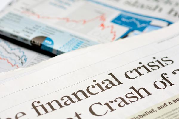 Newspaper showing financial crisis headline