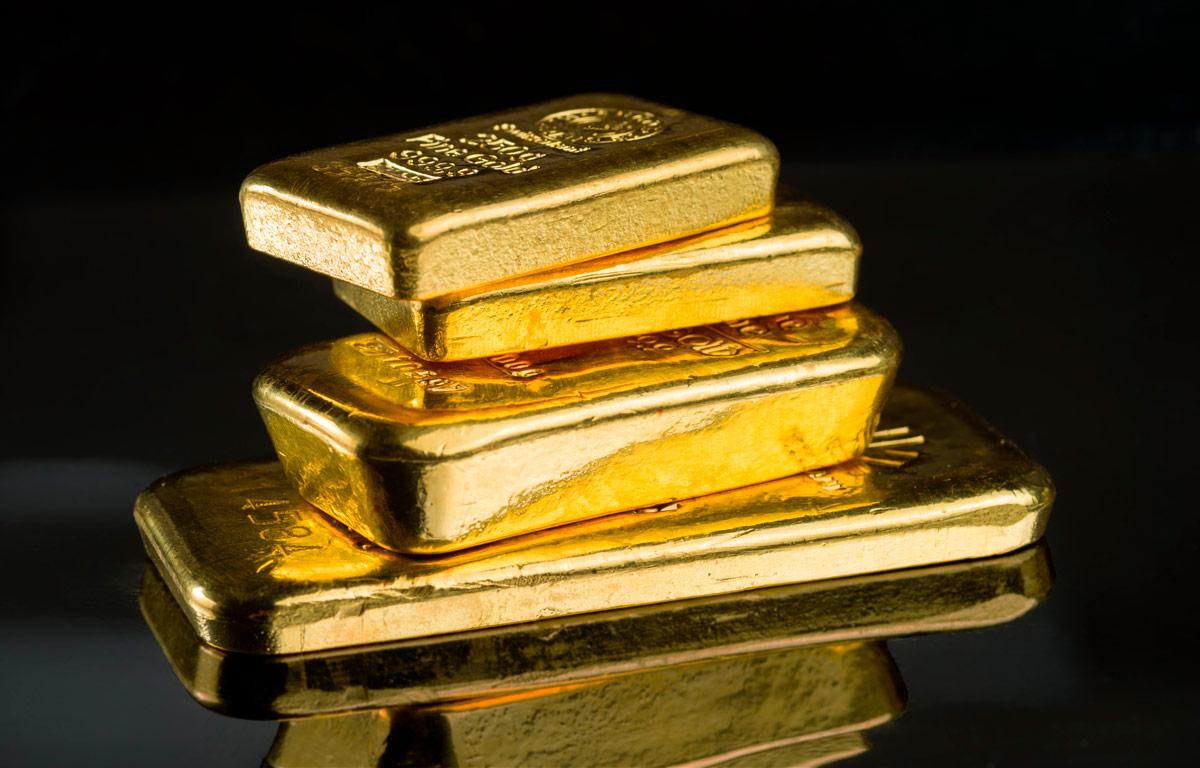 Gold bars on black background