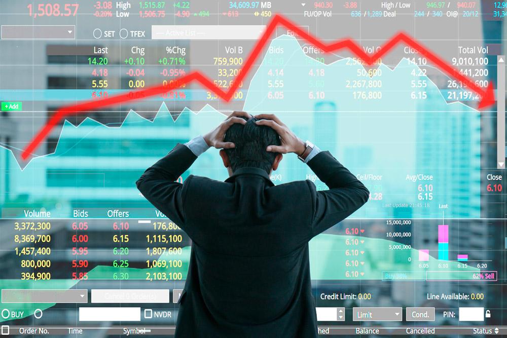 Man in panic looking at graphs