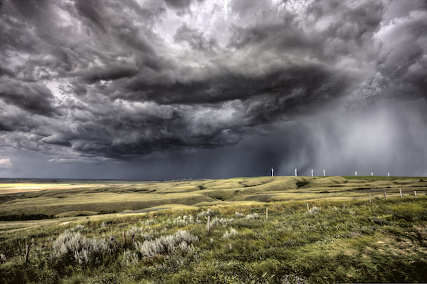 Storm clouds gather over field