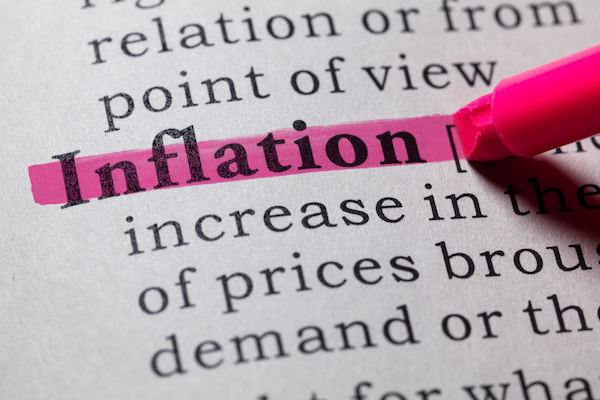 Pink highlighter over word 'inflation' in textbook.
